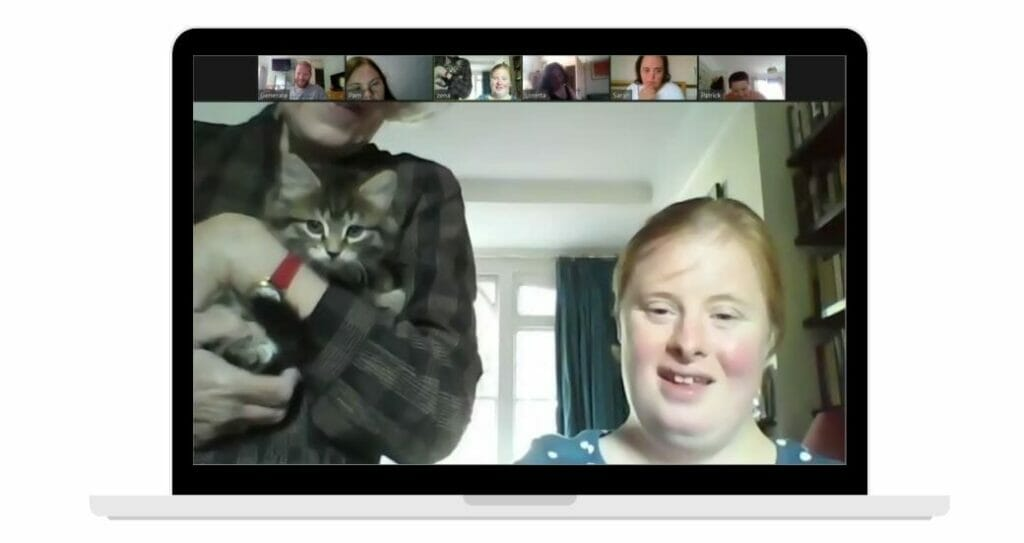 Chloe shows her cat to the group over zoom.